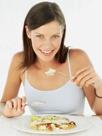 woman eating while suppressing appetite